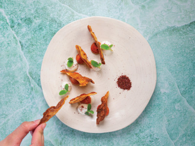 Crispy milk, brown butter with muhammara and labneh cream
